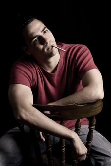 Young Handsome Guy Smoking Cigar Stock Photos