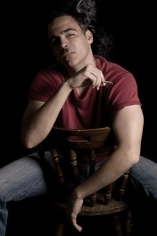 Young Handsome Guy Smoking Cigar Royalty Free Stock Image