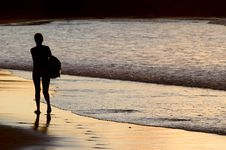 Silhouette Of Woman Walking By The Seaside Royalty Free Stock Images