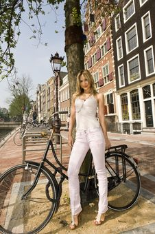 Free Woman Standing Next To Bicycle Stock Images - 10122124