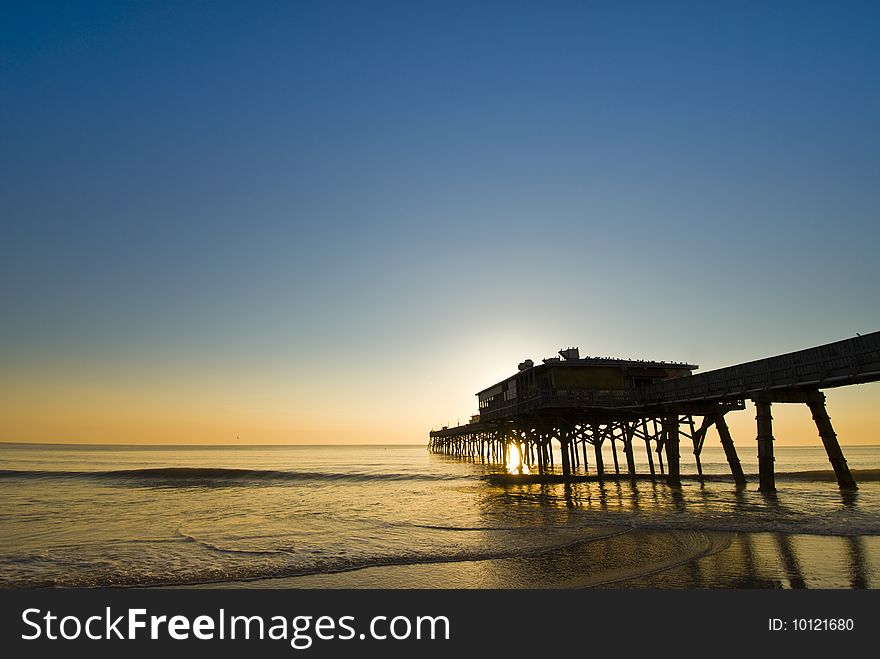 Colorful fishing pier sunrise