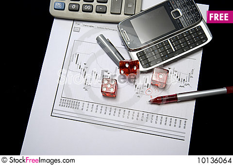Pair of dice on stock chart. Stock Photo