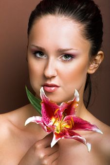 Free Beautiful Woman With A Flower Stock Image - 10134751