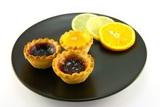 Jam Tarts With Citrus Slices Royalty Free Stock Image