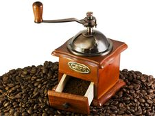 Free Coffee Grinders To Coffee Beans Stock Image - 10136551