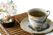 Cup Of Green Tea And Cash Isolated Tree On A White Royalty Free Stock Image