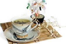 Cup Of Green Tea And Cash Isolated Tree On A White Stock Photography