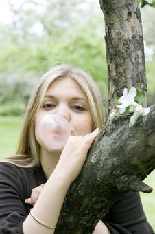 Playful Blond Girl Blowing Bubble Royalty Free Stock Photography