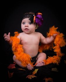 Free Baby In Fancy Dress With Feather Boa Royalty Free Stock Images - 101316799