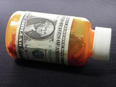 Free Closed Pill Bottle With Dollar Script Royalty Free Stock Image - 10142946