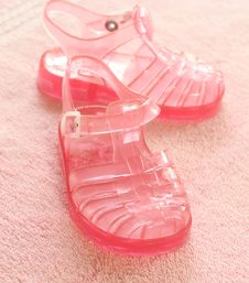 Free Pink Children S Footwear On Pink Towel Stock Image - 10144861