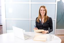 Free Business Woman Writing Notes At Desk Royalty Free Stock Photo - 10145715