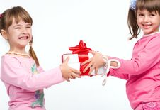 Free Little Girls Holding Gift Boxes Stock Image - 10146191