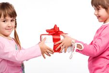 Free Little Girls Holding Gift Boxes Royalty Free Stock Photography - 10146197