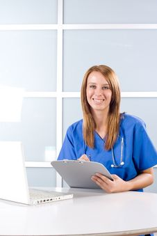 Free Female Nurse In A Modern Office Royalty Free Stock Images - 10146439
