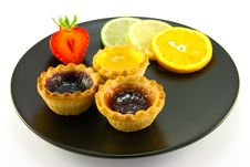 Jam Tarts On A Black Plate Stock Photo