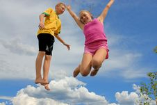 Free Siblings Jump High Stock Images - 10153234