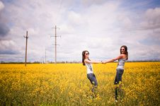 Women Having Fun In The Field Royalty Free Stock Photo
