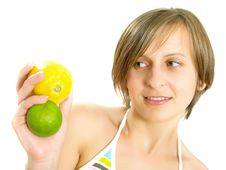 Free Cute Girl Showing Citrus Fruits Stock Photo - 10157570