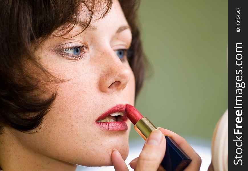 Beautiful women with   lipstick  make a  red lips.