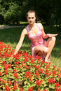 Free Smiling Girl Sitting Among Flowers Royalty Free Stock Photography - 10166197
