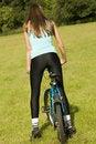 Free Woman Biking Stock Photography - 10169912