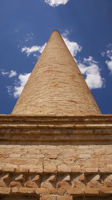 Old Brick Chimney Against The Blue Sky Royalty Free Stock Photos