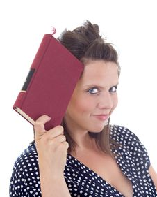 Free Young Woman Holding A Book To Her Head Royalty Free Stock Photography - 10172977