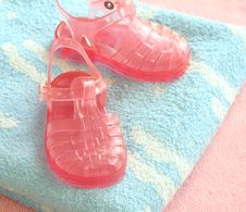 Free Pink Children S Footwear On Blue  Towels Royalty Free Stock Photo - 10176385