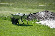 The Wheelbarrow On The Grass Royalty Free Stock Photos