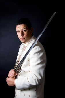 Aruban Algerian Man With Sword On Black Background Royalty Free Stock Image
