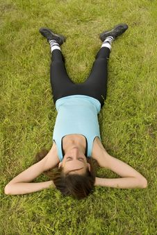 Free Woman Relaxing On Grass Stock Image - 10179251