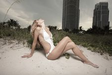 Young Woman Laying In The Dunes Royalty Free Stock Image