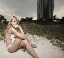Young Woman Laying In The Dunes Stock Photography