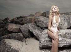 Free Woman Posing On The Rocks Stock Photos - 10183843