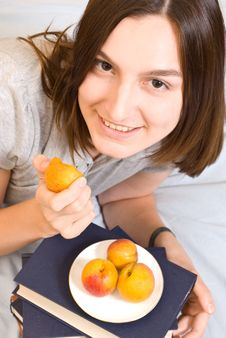 Young Woman With  Peach Stock Photos