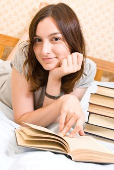Free Smiling Student  Reads A Book Stock Photos - 10187293