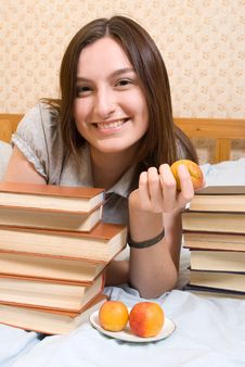 Young Woman With  Peach And Books Royalty Free Stock Photos