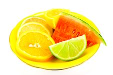 Citrus Fruit On A Yellow Plate Royalty Free Stock Photo