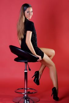 Beautiful Young Woman On A Chair Royalty Free Stock Photo