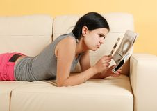 Girl Reading A Newspaper Royalty Free Stock Photography