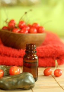 Free Bottle Of Essence Oil, Fresh Cherry And Red Towel Royalty Free Stock Photo - 10190515