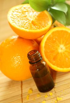 Bottle Of Essence Oil And Fresh Oranges Royalty Free Stock Images