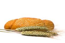 Single Fresh Bun And Ears Of Wheat Stock Photography