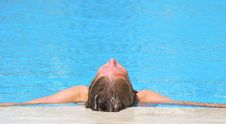 Woman Relaxing In Blue Outdoor Swimming Waterpool Stock Images