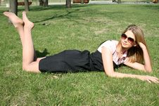 Free Girl Lying On Grass Royalty Free Stock Photography - 10191707