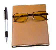 Free Electronic Organizer With Glasses And Pen On White Stock Images - 10192074