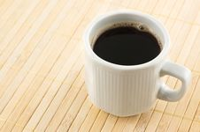 Free Coffee Cup On A Bamboo Mat. Royalty Free Stock Photo - 10194915