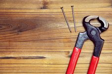 Nail And Nail Puller On A Wood Board Royalty Free Stock Photos