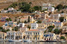 Multicolored Houses On An Island Symi Royalty Free Stock Photography